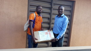 Dayo adetiloye receiving His Laptop from h2i
